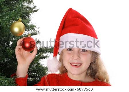 Santa child showing ornaments on tree - stock photo