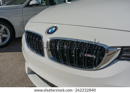 SANTA CLARA, CA/USA - FEBRUARY 16: BMW m4 car on display on Feb 16, 2015 in Santa Clara, CA. BMW is a German automobile, motorcycle and engine manufacturing company, headquartered in Munich. - stock photo