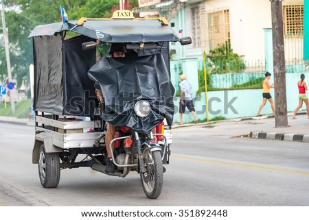 SANTA CLARA,CUBA-APRIL 5,2015: Old obsolete vehicles circulating in the Cuban streets. These transportation means are both a tourist attraction and a leading cause of death by accidents in the country