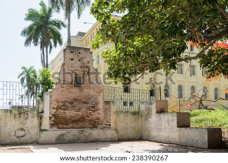 SANTA CLARA,CUBA-AUGUST 20,2014: Historic wall of the Tarragona barracks where independentists were executed by fire arms in the colonial era. This wall is proposed for Cuban National Monument.