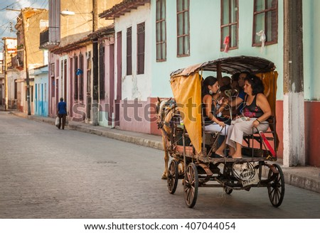SANTA CLARA, CUBA - CIRCA AUGUST 2015: Cubans riding horse drawn cart in Santa Clara, Cuba.