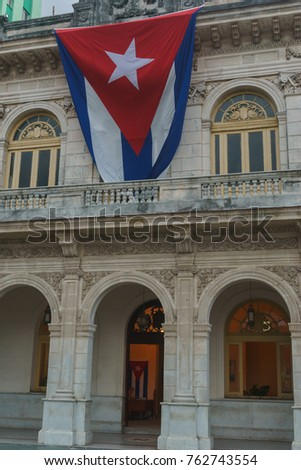 Santa Clara, Cuba, January 5, 2017: Official building with cuban flag at outdoors