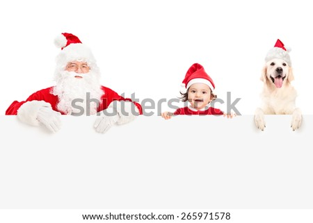 Santa Claus, a cute baby girl and a Labrador retriever dog posing behind a blank signboard isolated on white background - stock photo