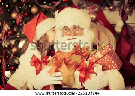 Santa Claus and child at home. Christmas gift. Family holiday concept - stock photo