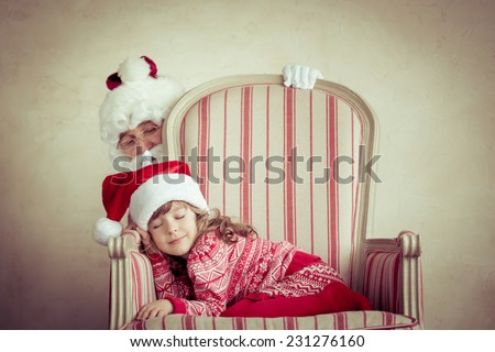 Santa Claus and child at home. Christmas miracle. Family holiday concept - stock photo