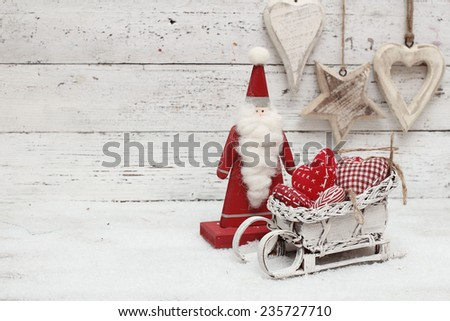 Santa Claus and christmas decoration on wooden background in scandinavian style - stock photo