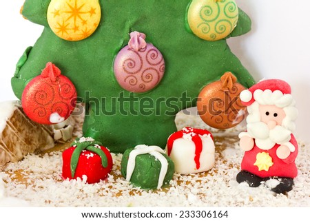 Santa Claus and Christmas tree made of gingerbread - stock photo