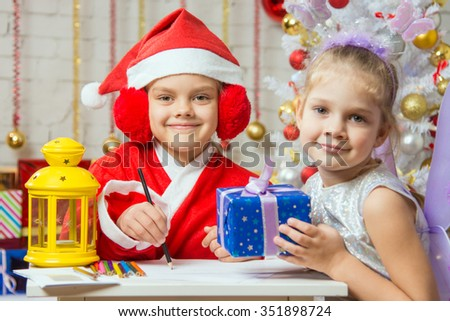 Santa Claus and fairy helper prepared greeting cards and presents