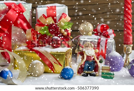 Santa Claus and Gift decoration for merry christmas and happy new year on snowing day / Image Select focus