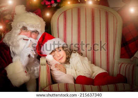 Santa Claus and happy kid. Children dream. Christmas holiday concept. Xmas miracle - stock photo