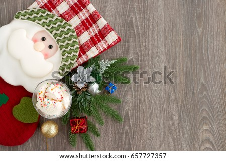 Santa Claus and ice cream. Santa Claus in the form of a Christmas sock, spruce branches and ice cream is seen from above. Good New Year spirit. Ice cream is a New Year's dessert.