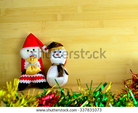 "Santa claus and snowmant, they say ""Merry Christmas"""