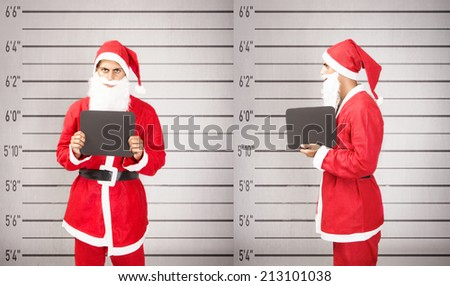 Santa Claus arrested in a prison situation - stock photo