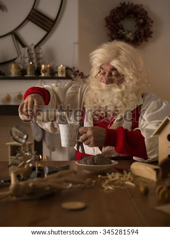 Santa Claus at Home. Drinking milk and Eating Cookies
