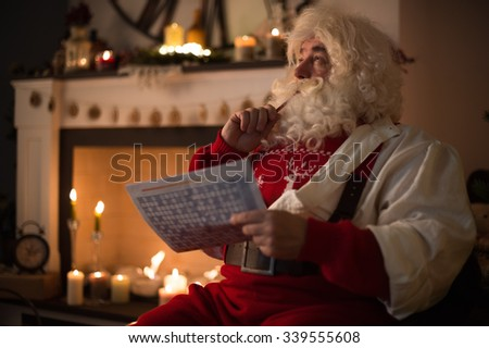 Santa Claus at Home resting near fireplace