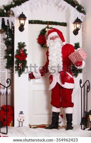 Santa Claus at the door. He brought a gift. Christmas, New Year