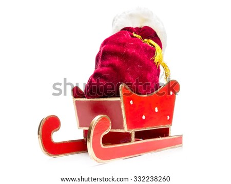 Santa Claus bag full of christmas presents in red sleigh over white background - stock photo