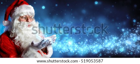 Santa Claus Blowing Magic Christmas Stars In Snowy Night