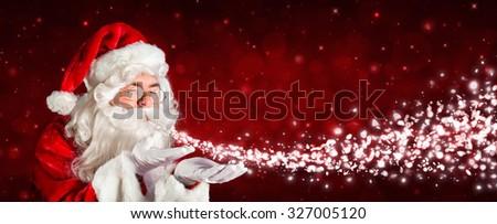 Santa Claus Blowing Snow  - stock photo