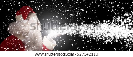 Santa Claus breathing magic snow