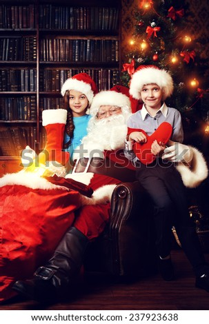 Santa Claus brought gifts for children. Christmas scene.  - stock photo