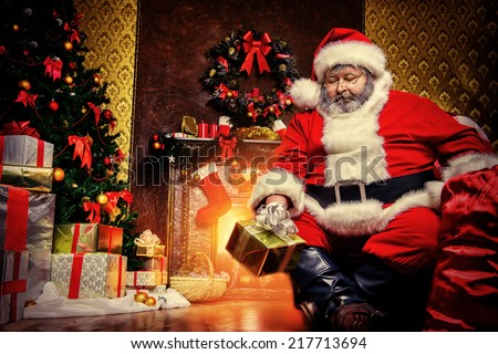 Santa Claus brought gifts for Christmas. Christmas home decoration.