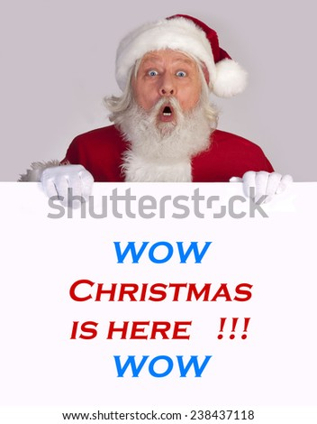 Santa Claus - Christmas figure of Santa Claus with a big sign - stock photo