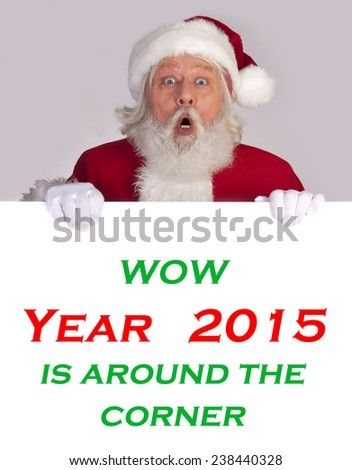 Santa Claus - Christmas figure of Santa Claus with a big sign announced year 2015 - stock photo