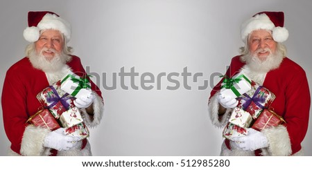 Santa Claus - Christmas figure of Santa Claus with gifts and boxes