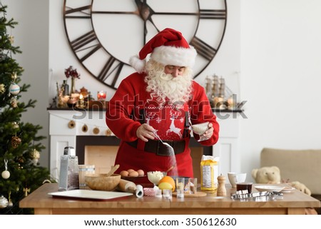 Santa Claus Cooking at Home Christmas Cookies - stock photo