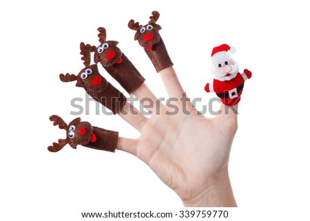 Santa claus deer toy christmas decoration on the hand. Humorous concept festive fun - stock photo