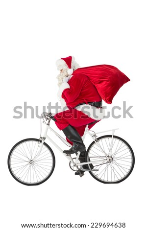 Santa claus delivering gifts with bicycle on white background - stock photo