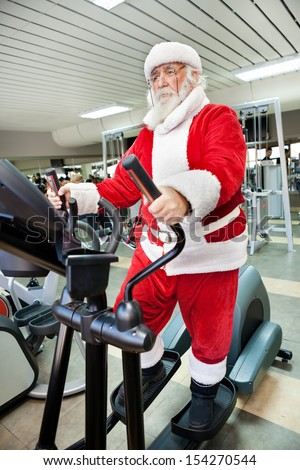Santa Claus  doing exercises before delivering presents - stock photo
