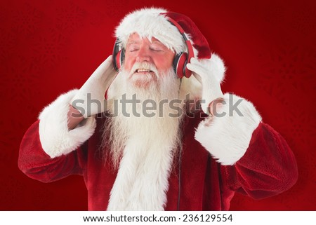 Santa Claus enjoys some music against red background