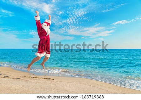 Santa Claus flying against sea beach and sky - Christmas concept - stock photo