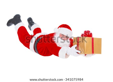 Santa Claus flying fall over with big Christmas packed golden gift box surprise isolated on white background, New Year's Day or X-mas concept