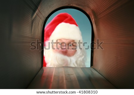 Santa Claus gets his mail from his mail box, as seen from the inside out
