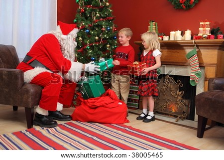 santa claus gives christmas gifts to children - Santa Claus Children