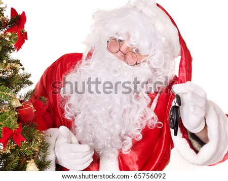 Santa Claus giving auto keys by christmas tree. Isolated.
