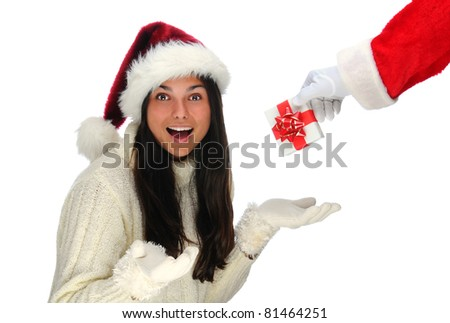 Santa Claus handing a small Christmas present to a young woman with a  surprised expression on her face. Only Santa's arm and present are visible. Horizontal format over white.