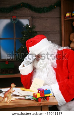 Santa Claus has a Head Ache from being over worked and stress before christmas - stock photo