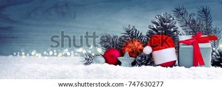 Santa Claus hat and red Christmas decoration.