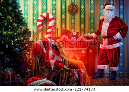 Santa Claus having a rest near the fireplace at home.