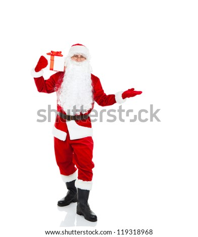 Santa Claus hold gift box present point open palm, with blank empty copy space for Text isolated over white background, concept of christmas new year sale shopping - stock photo