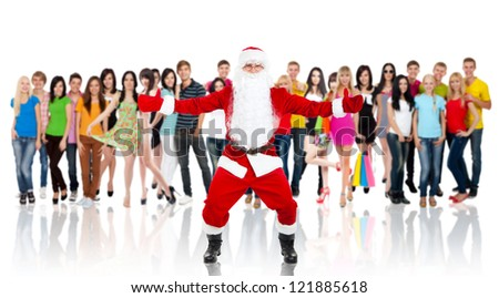 Santa Claus hold wide open palm gesture full length portrait with raised gloves hands arms over big group of casual people diverse student background, concept merry christmas time and happy new year - stock photo