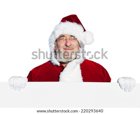 Santa claus holding a blank sign.