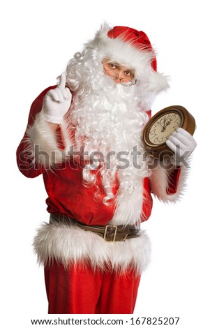 Santa Claus holding a clock showing several  minutes to midnight