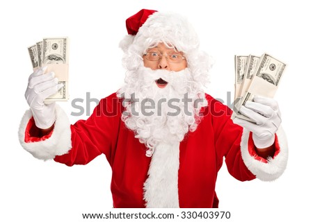 Santa Claus holding few stacks of money and looking at the camera isolated on white background - stock photo