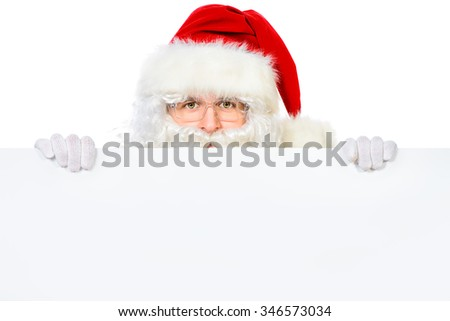 Santa Claus holding white billboard. Isolated over white background. Copy space. Christmas.