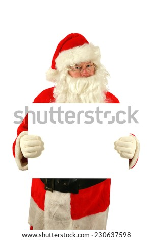 Santa Claus holds and points to a white blank sign with smile, isolated on white with room for your text. Santa Claus wants to help you sell your product or service with this image. Santa is like that - stock photo